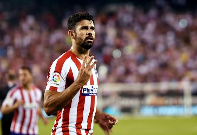 Atletico Madrid's Diego Costa celebrates after scoring his third goal in a 7-3 rout of Real Madrid in a pre-season friendly at MetLife Stadium (AFP Photo/Johannes EISELE)