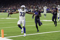 Indianapolis Colts running back Jonathan Williams (33) celebrates as he scores a touchdown against the Houston Texans during the second half of an NFL football game Thursday, Nov. 21, 2019, in Houston. (AP Photo/Mike Marshall)