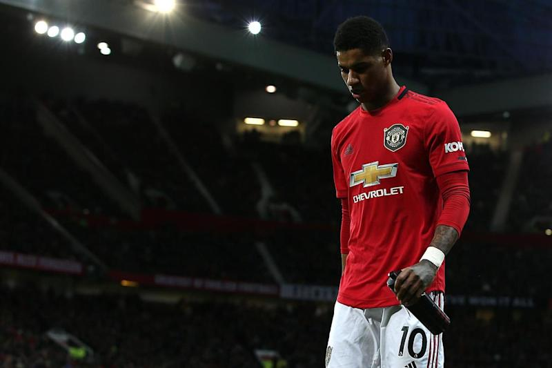 Rashford is facing a spell on the sidelines after suffering a double stress fracture of the back: Manchester United via Getty Images