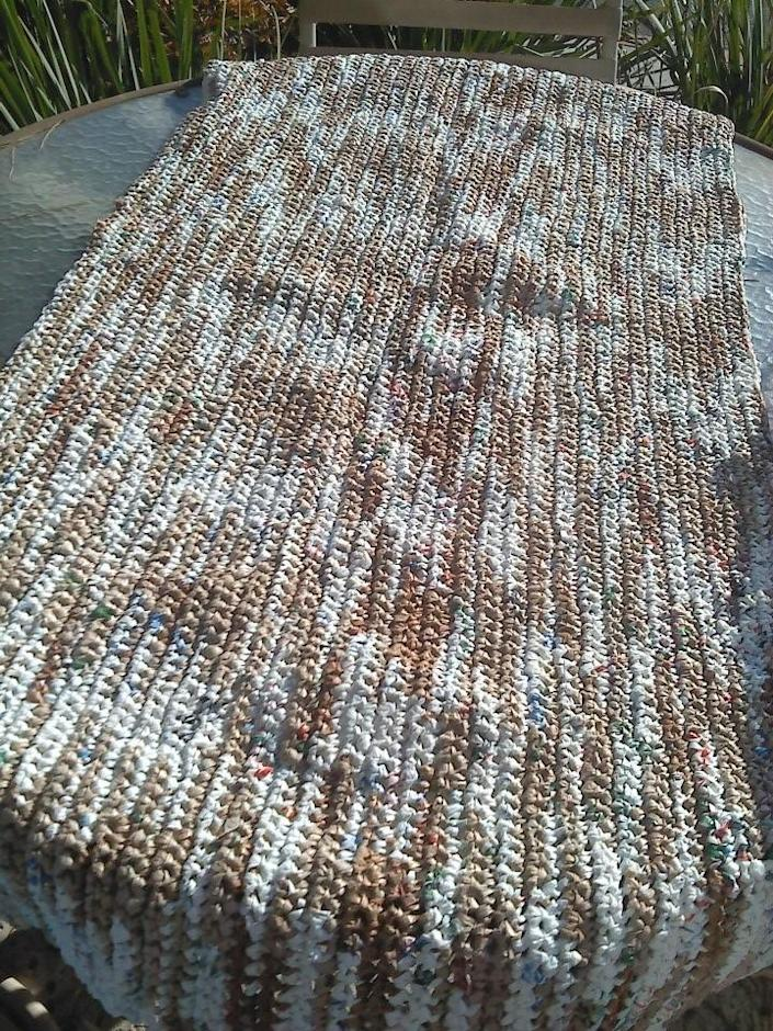 """<p>Check out <a href=""""http://www.1millionwomen.com.au/blog/diy-crochet-plastic-bags-sleeping-mats-homeless/"""" rel=""""nofollow noopener"""" target=""""_blank"""" data-ylk=""""slk:this instructional video"""" class=""""link rapid-noclick-resp"""">this instructional video</a>, or <a href=""""http://www.instructables.com/id/How-to-Make-a-Rug-from-Plastic-Grocery-Bags/"""" rel=""""nofollow noopener"""" target=""""_blank"""" data-ylk=""""slk:amend those instructions and make a plastic bag rug"""" class=""""link rapid-noclick-resp"""">amend those instructions and make a plastic bag rug</a>. If you decide to crochet a mat to gift to a shelter, ask your local shelters to see if they'd be interested in accepting it. <i>(Photo: <a href=""""http://www.1millionwomen.com.au/blog/diy-crochet-plastic-bags-sleeping-mats-homeless/"""" rel=""""nofollow noopener"""" target=""""_blank"""" data-ylk=""""slk:1 Million Women"""" class=""""link rapid-noclick-resp"""">1 Million Women</a>)</i></p>"""