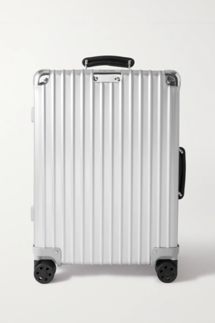 """<p><strong>Rimowa</strong></p><p>net-a-porter.com</p><p><strong>$1190.00</strong></p><p><a href=""""https://go.redirectingat.com?id=74968X1596630&url=https%3A%2F%2Fwww.net-a-porter.com%2Fen-us%2Fshop%2Fproduct%2Frimowa%2Fbags%2Fsuitcases%2Fclassic-cabin-aluminum-suitcase%2F20346390236288542&sref=https%3A%2F%2Fwww.harpersbazaar.com%2Ffashion%2Ftrends%2Fg37684777%2Fromantic-gift-ideas-for-women%2F"""" rel=""""nofollow noopener"""" target=""""_blank"""" data-ylk=""""slk:Shop Now"""" class=""""link rapid-noclick-resp"""">Shop Now</a></p><p>This gift is best paired with a ticket to get out of town.</p>"""
