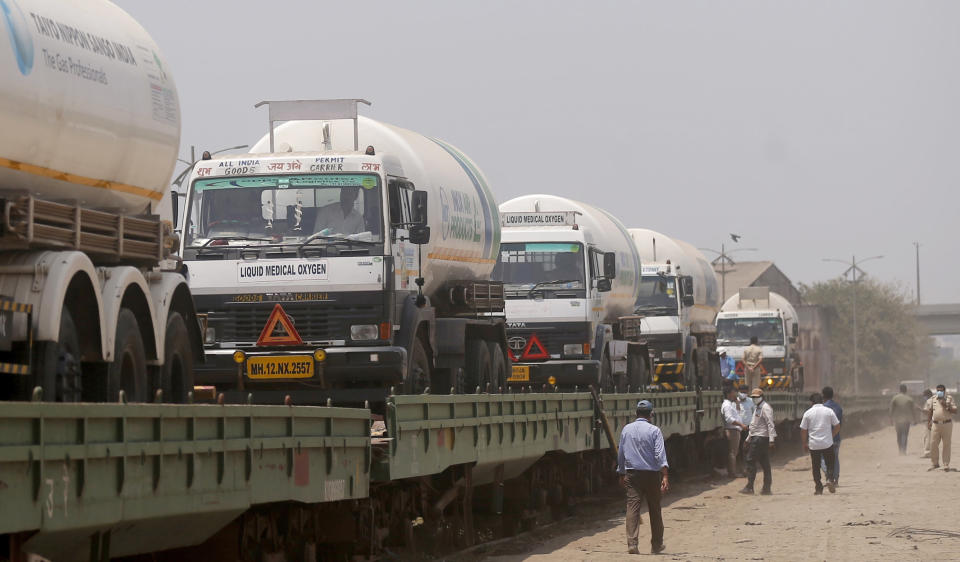 Empty tankers are loaded on a train wagon at the Kalamboli goods yard in Navi Mumbai, Maharashtra state, India, before they are transported to collect liquid medical oxygen from other states, Monday, April 19, 2021. The western Maharashtra state, which is worst hit by the coronavirus is facing a shortage of the gas used for the treatment of COVID-19 patients. India is being overrun by hundreds of thousands of new coronavirus cases, bringing a new reality for daily life in its main cities and towns. (AP Photo/Rafiq Maqbool)