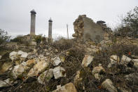 The Aghdam Mosque is seen through ruins in Agdam, prior to the Azerbaijani forces being handed control in the separatist region of Nagorno-Karabakh, Thursday, Nov. 19, 2020. The mosque itself is an especial sore point. In the years after the local population was driven out the mosque was turned into a stable for cattle and swine. Although ethnic Armenian forces tried to keep outsiders away from Aghdam, some camera-bearing visitors slipped in and their photos of the mosque's defilement outraged Azerbaijanis. (AP Photo/Sergei Grits)