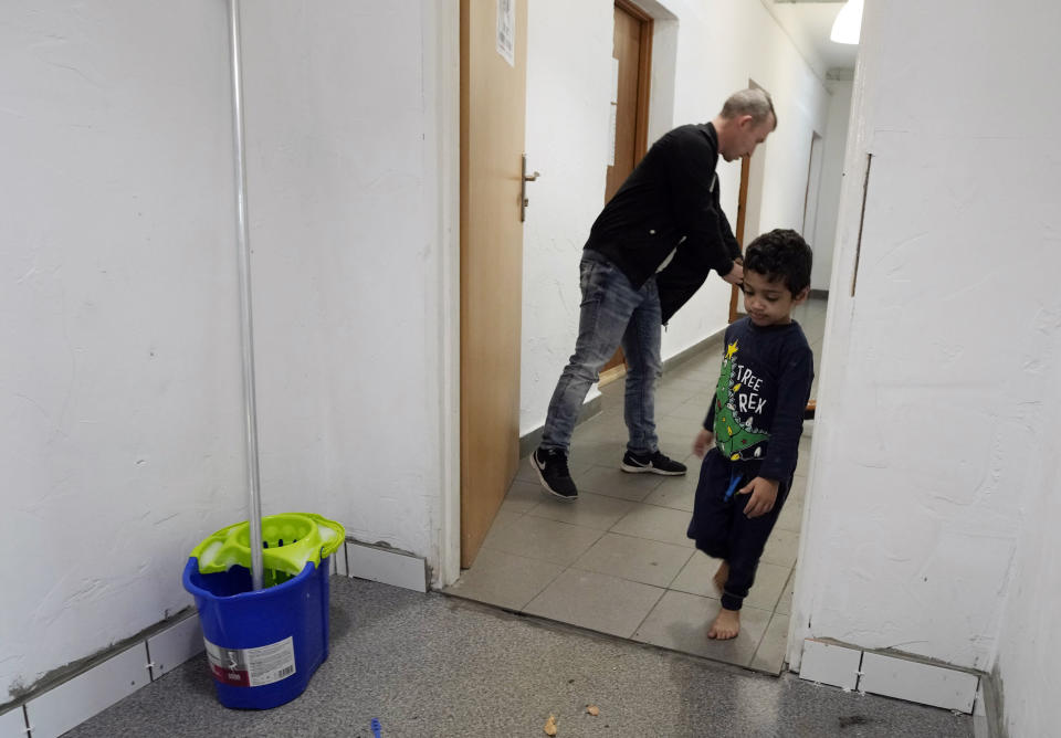 """A boy play at a refugee center in Bialystok, Poland, on Wednesday, Sept. 29, 2021. After enduring a decade of war in Syria, Boshra al-Moallem and her two sisters seized their chance to flee, but the journey proved terrifying and nearly deadly. Al-Moallem, originally from Homs but who displaced to Damascus by the war, is one of thousands of people who have traveled to Belarus in recent weeks and then found herself helped to cross the border with the help of Belarusian guards, something the EU considers a form of """"hybrid war"""" waged against the bloc with the use of human lives. (AP Photo/Czarek Sokolowski)"""