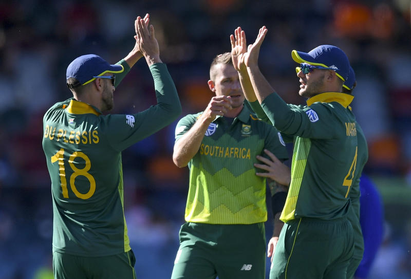 Aiden Markram, right, of South Africa celebrates with teammates after taking a wicket during a tour warm-up match against Australia Prime Minister's XI during their limited overs cricket match in Canberra, Wednesday, Oct. 31, 2018. (Lukas Coch/AAP Image via AP)
