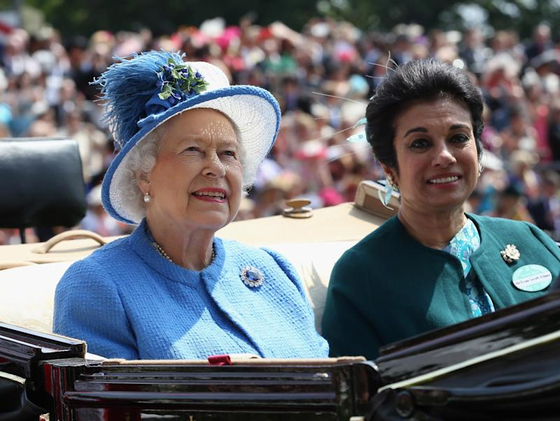 Queen Elizabeth and Princess Sarvath El Hassan of Jordan attend the Royal Ascot in 2013 (Getty Images)
