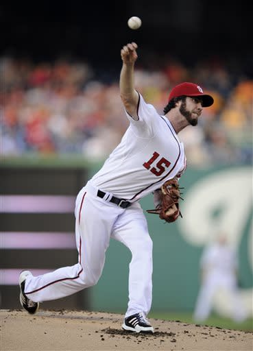 Washington Nationals starting pitcher Dan Haren delivers a pitch against the Pittsburgh Pirates during the first inning of a baseball game, Monday, July 22, 2013, in Washington. (AP Photo/Nick Wass)