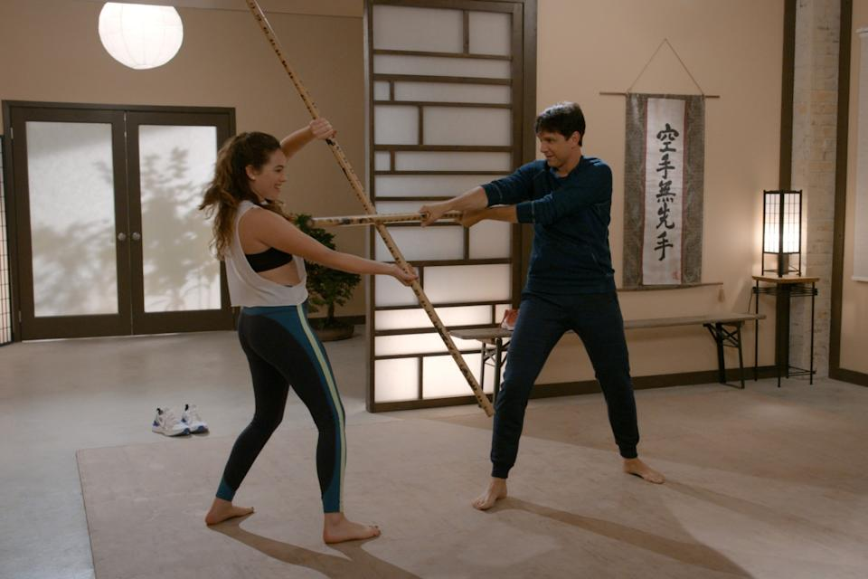 """Mary Mouser as Samantha LaRusso and and Ralph Macchio as Daniel LaRusso in """"Cobra Kai."""""""