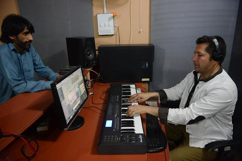 Popular Pashto singer Bakhtiar Khattak (R) records a song at a studio in Peshawar (AFP Photo/A Majeed)
