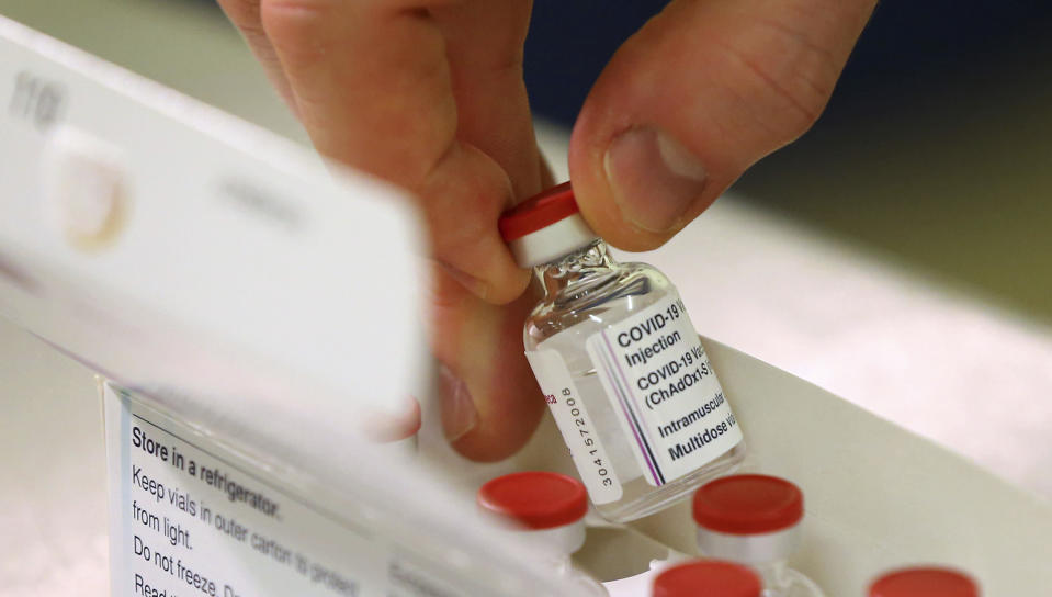 FILE - In this Saturday Jan. 2, 2021 file photo, doses of the COVID-19 vaccine developed by Oxford University and U.K.-based drugmaker AstraZeneca are checked as they arrive at the Princess Royal Hospital in Haywards Heath, England. Britain races to vaccinate more than 15 million people by mid-February, and in an effort to ensure vaccines get to the right places at the right times, along with the syringes, alcohol swabs and protective equipment needed to administer them, the government has called in the army. (Gareth Fuller/Pool via AP, File)