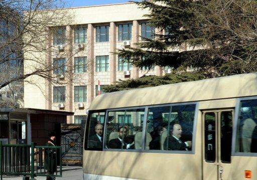 US negotiator Glyn Davies and his team leave the North Korean embassy in Beijing after bilateral talks