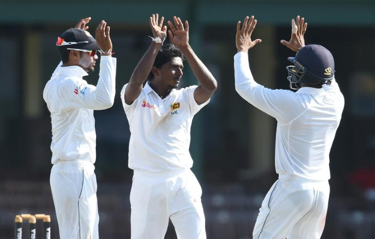Sri Lankan's Lakshan Sandakan (centre) celebrates after he dismissed Bangladesh batsman Soumya Sarkar on the second day of the second Test in Colombo on March 16, 2017