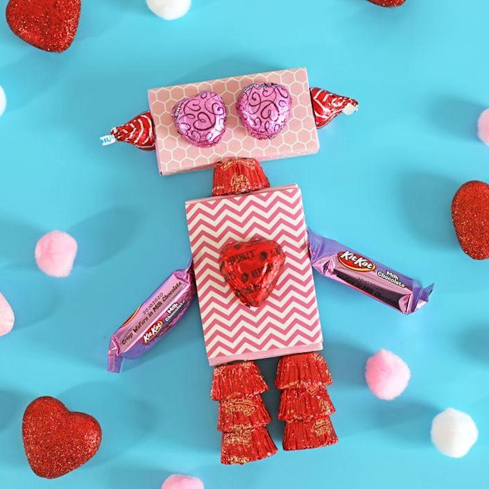 """<p>This robot is so cute that your kids might rather play with it than eat it!</p><p><strong>Get the tutorial at <a href=""""https://www.thecraftpatchblog.com/valentinesdaycrafts/"""" rel=""""nofollow noopener"""" target=""""_blank"""" data-ylk=""""slk:The Craft Patch"""" class=""""link rapid-noclick-resp"""">The Craft Patch</a>.</strong></p><p><strong><a class=""""link rapid-noclick-resp"""" href=""""https://www.amazon.com/Cobiz-Premium-Sticks-Christmas-Decoration/dp/B0721PTD5B/?tag=syn-yahoo-20&ascsubtag=%5Bartid%7C10050.g.1584%5Bsrc%7Cyahoo-us"""" rel=""""nofollow noopener"""" target=""""_blank"""" data-ylk=""""slk:SHOP HOT GLUE GUNS"""">SHOP HOT GLUE GUNS</a><br></strong></p>"""