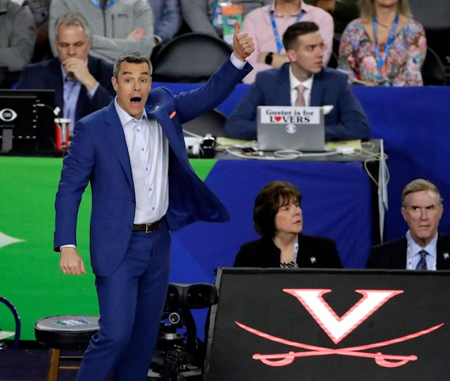 Virginia head coach Tony Bennett directs his team during the first half against Auburn in the semifinals of the Final Four NCAA college basketball tournament, Saturday, April 6, 2019, in Minneapolis. (AP Photo/Matt York)