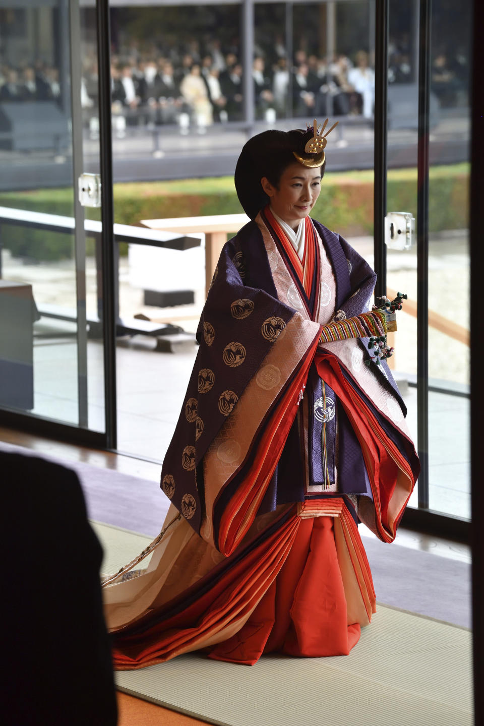 Japan's Crown Princess Kiko leaves at the end of the enthronement ceremony where Emperor Naruhito officially proclaimed his ascension to the Chrysanthemum Throne at the Imperial Palace in Tokyo, Tuesday, Oct. 22, 2019. (Kazuhiro Nogi/Pool Photo via AP)