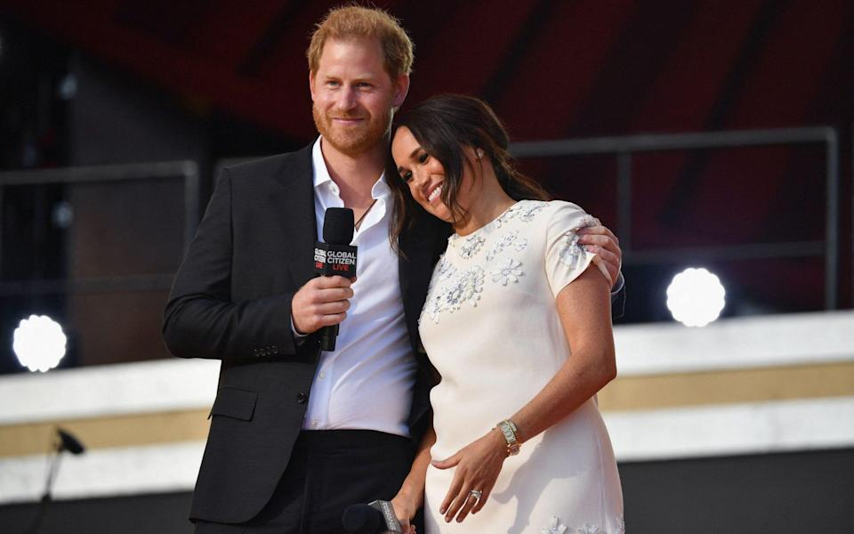 Prince Harry and Meghan Markle speak during the 2021 Global Citizen Live festival - AFP