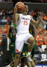 Virginia guard Malcolm Brogdon (15) goes to the basket during an NCAA college basketball game against Norfolk State, Sunday Nov. 16, 2014 in Charlottesville, Va. (AP Photo/Andrew Shurtleff)