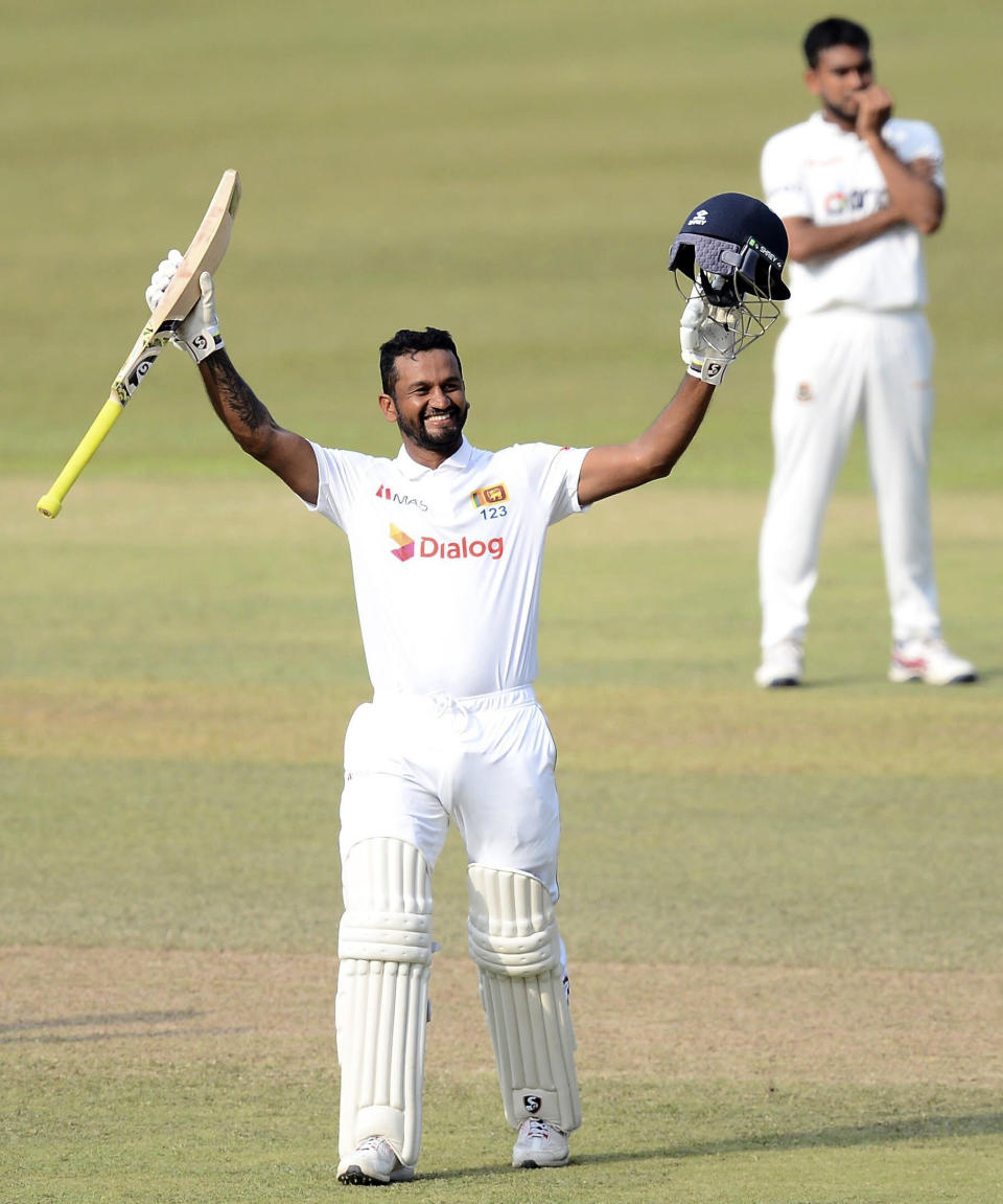 Sri Lanka batsman Dimuth Karunaratne celebrates scoring his double century during the fourth day of the first test cricket match between Sri Lanka and Bangladesh in Pallekele, Sri Lanka, Saturday, April 24, 2021.( AP Photo/Sameera Peiris)
