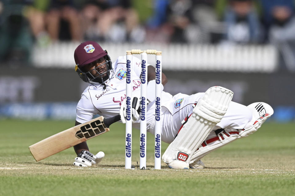 West Indies's Jermaine Blackwood falls to the ground while batting against New Zealand during play on day three of their first cricket test in Hamilton, New Zealand, Saturday, Dec. 5, 2020. (Andrew Cornaga/Photosport via AP)