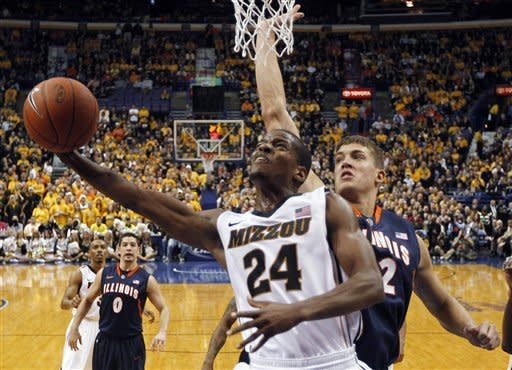 Missouri's Kim English (24) heads to the basket past Illinois' Meyers Leonard during the first half of an NCAA college basketball game Thursday, Dec. 22, 2011, in St. Louis. Missouri won 78-74. (AP Photo/Jeff Roberson)