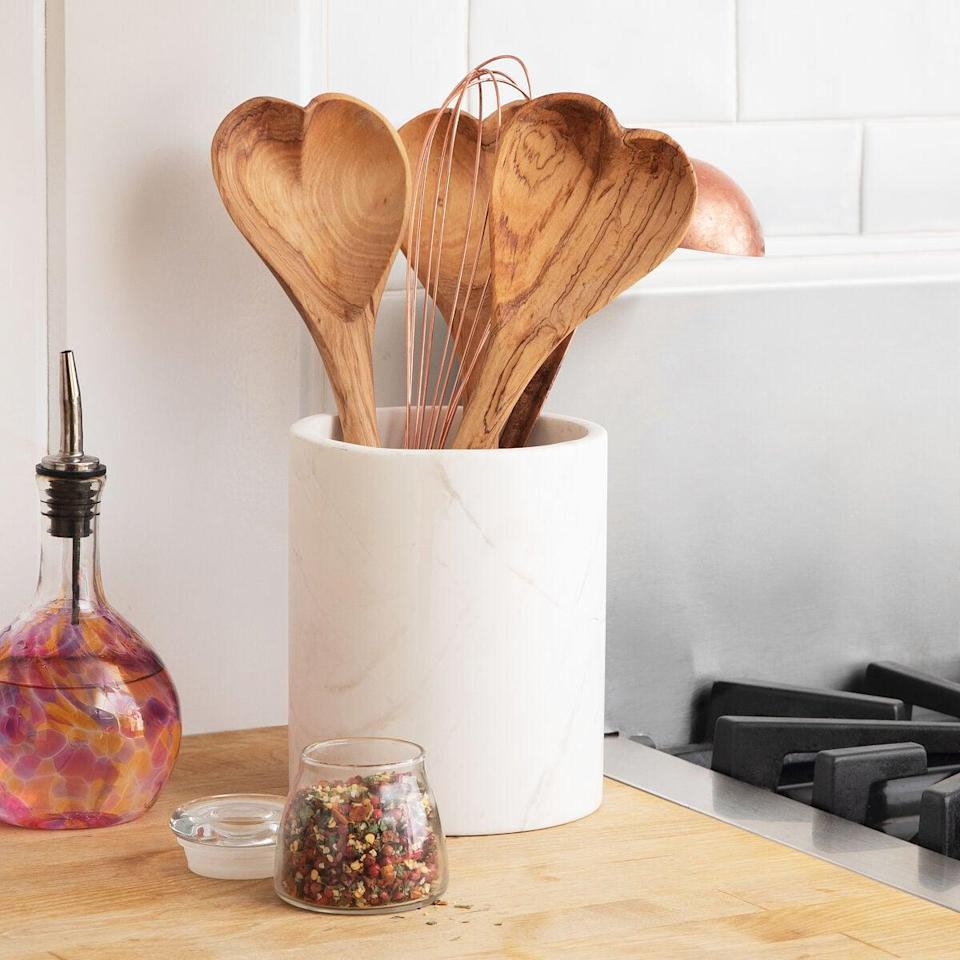 <p>The cook in your life will love this <span>Hand-Carved Heart Serving Spoon</span> ($20).</p>