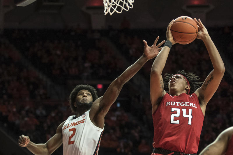 Rutgers' Ron Harper, Jr (24) puts up a shot as Illinois' Kipper Nichols (2) defends in the second half of an NCAA college basketball game, Sunday, Jan. 11, 2020, in Champaign, Ill. (AP Photo/Holly Hart)
