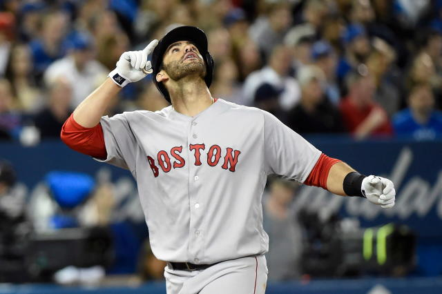 Boston Red Sox's J.D. Martinez reacts after hitting a three-run home run against the Toronto Blue Jays during the fifth inning inning of a baseball game in Toronto on Thursday, April 26, 2018. (Nathan Denette/The Canadian Press via AP)