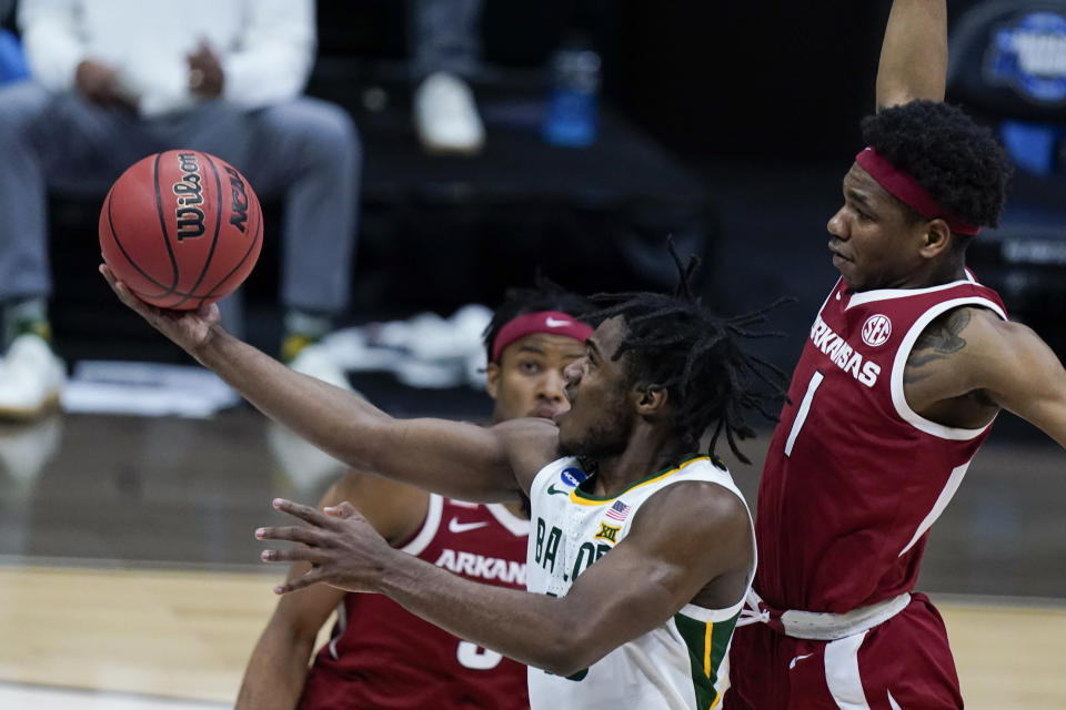 Baylor guard Davion Mitchell drives to the basket ahead of Arkansas guard JD Notae (1) during the second half of an Elite 8 game in the NCAA men's college basketball tournament at Lucas Oil Stadium, Monday, March 29, 2021, in Indianapolis. (AP Photo/Michael Conroy)