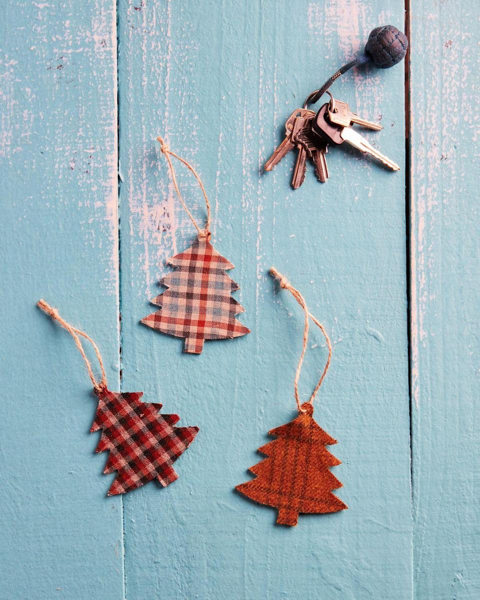 """<p>Help dad keep his car smelling fresh with a DIY tree-shaped air freshener. Added bonus—they are made with essential oils so no nasty chemicals involved.<br><strong><br>To make:</strong> Trace the shape of a wooden Christmas tree ornament on a scrap of fabric twice. Cut out and glue to the front and back of the ornament. Once dry, soak the fabric with dads favorite scent of essential oil (we used <a href=""""https://www.etsy.com/listing/239354350/cedarwood-essential-oil-pure-cedarwood"""" rel=""""nofollow noopener"""" target=""""_blank"""" data-ylk=""""slk:cedar"""" class=""""link rapid-noclick-resp"""">cedar</a>). Thread twine through the loop for hanging.<br><br><a class=""""link rapid-noclick-resp"""" href=""""https://www.amazon.com/Tiparts-Christmas-Cutouts-Ornaments-Decoration/dp/B07L3GCWXM?tag=syn-yahoo-20&ascsubtag=%5Bartid%7C10050.g.1171%5Bsrc%7Cyahoo-us"""" rel=""""nofollow noopener"""" target=""""_blank"""" data-ylk=""""slk:SHOP ORNAMENTS"""">SHOP ORNAMENTS</a></p>"""