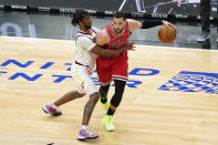 Chicago Bulls guard Zach LaVine, right, drives against Cleveland Cavaliers guard Darius Garland during the second half of an NBA basketball game in Chicago, Wednesday, March 24, 2021. The Cleveland Cavaliers won 103-94. (AP Photo/Nam Y. Huh)