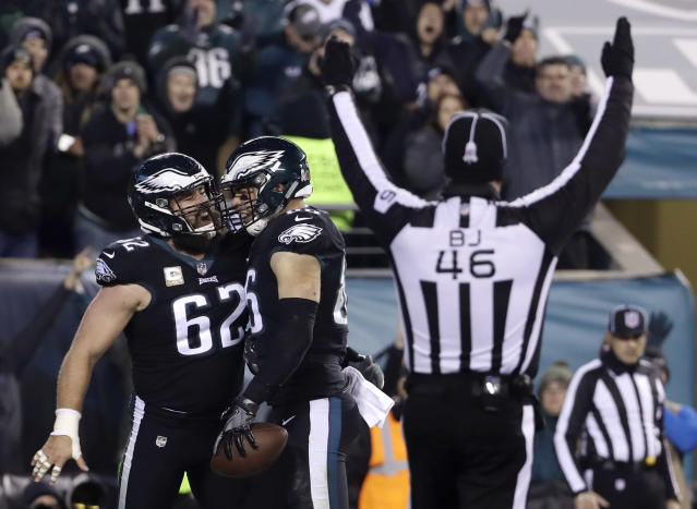 FILE - In this Nov. 11, 2018, file photo, Philadelphia Eagles tight end Zach Ertz (86) celebrates his touchdown catch with center Jason Kelce (62) as back judge Perry Paganelli (46) gestures during the second half of an NFL football game against the Dallas Cowboys, in Philadelphia. The Cowboys saved their season with a win in Philadelphia a month ago. Now Carson Wentz and the defending champion Eagles are trying to do the same in Texas against first-place Dallas on Sunday.(AP Photo/Matt Slocum, File)