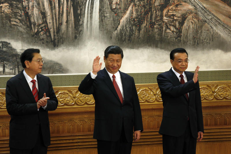 From left, members of the new Politburo Standing Committee Zhang Dejiang, Xi Jinping, Li Keqiang meet journalists in Beijing's Great Hall of the People Thursday Nov. 15, 2012. The seven-member Standing Committee, the inner circle of Chinese political power, was paraded in front of assembled media on the first day following the end of the 18th Communist Party Congress. (AP Photo/Vincent Yu)