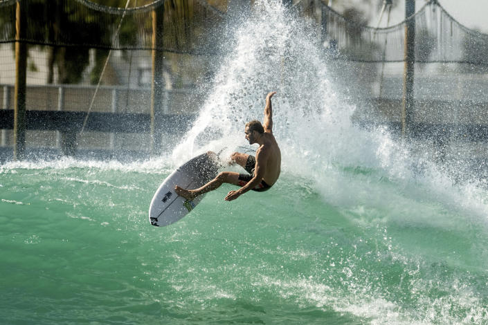 FILE - In this Tuesday, June 15, 2021 file photo, Portuguese surfer Frederico Morais practices for a World Surf League competition at Surf Ranch, in Lemoore, Calif. Portugal's Olympic team says that surfer Frederico Morais will miss the Games after having tested positive for the coronavirus despite being vaccinated. The team says that Morais won't travel to Tokyo on Friday, July 23, 2021 as planned. The 29-year-old Morais qualified for the Games after finishing as the top-ranked European surfer at the 2019 World Surfing Games held in Japan. (AP Photo/Noah Berger, File)