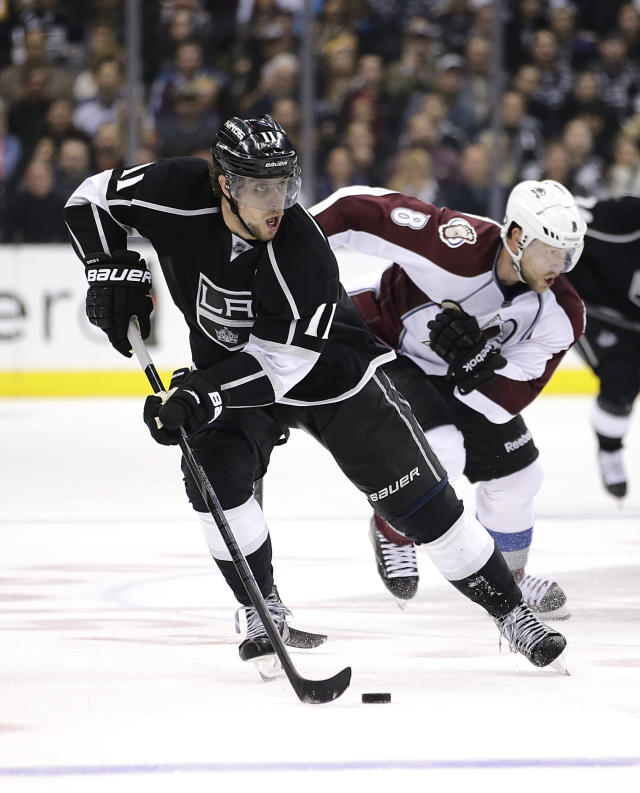 Los Angeles Kings' Anze Kopitar, front, of Slovenia, skates past Colorado Avalanche's Jan Hejda, of the Czech Republic, during the second period of an NHL hockey game on Saturday, Nov. 23, 2013, in Los Angeles.(AP Photo/Jae C. Hong)