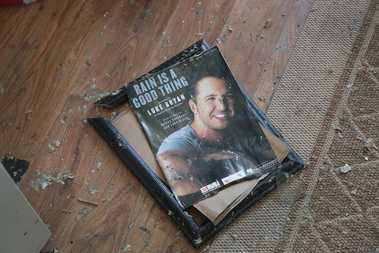 A framed memento from her son's music career lays broken on the floor of the home of LeClaire Bryan, mother of country music artist Luke Bryan, after it was severely damaged by Hurricane Michael on October 19, 2018 in Mexico Beach, Florida.