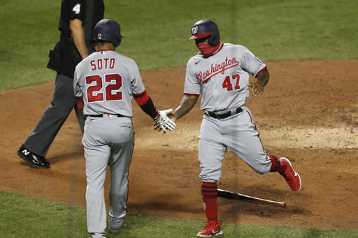 Washington Nationals' Juan Soto (22) celebrates with designated hitter Howie Kendrick (47) after the pair scored on Asdrubal Cabrera's fifth-inning double in a baseball game against the New York Mets, Monday, Aug. 10, 2020, in New York. (AP Photo/Kathy Willens)