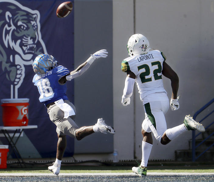 Memphis receiver Tahj Washington (18) stretches out for an overthrown ball during the first quarter of an NCAA college football game against South Florida, Saturday, Nov. 7, 2020, in Memphis, Tenn. (Patrick Lantrip/Daily Memphian via AP)