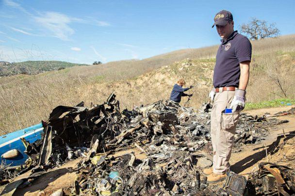PHOTO: Photo taken Jan. 27, 2020, shows National Transportation Board (NTSB) investigators Adam Huray and Carol Hogan examining the wreckage of the Jan. 26 helicopter crash near Calabasas, Calif., which killed nine people. (National Transportation Board)