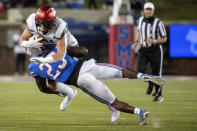 Cincinnati tight end Josh Whyle is taken down by SMU defensive back Brandon Stephens (23) during the first half of an NCAA college football game Saturday, Oct. 24, 2020, in Dallas. (AP Photo/Jeffrey McWhorter)