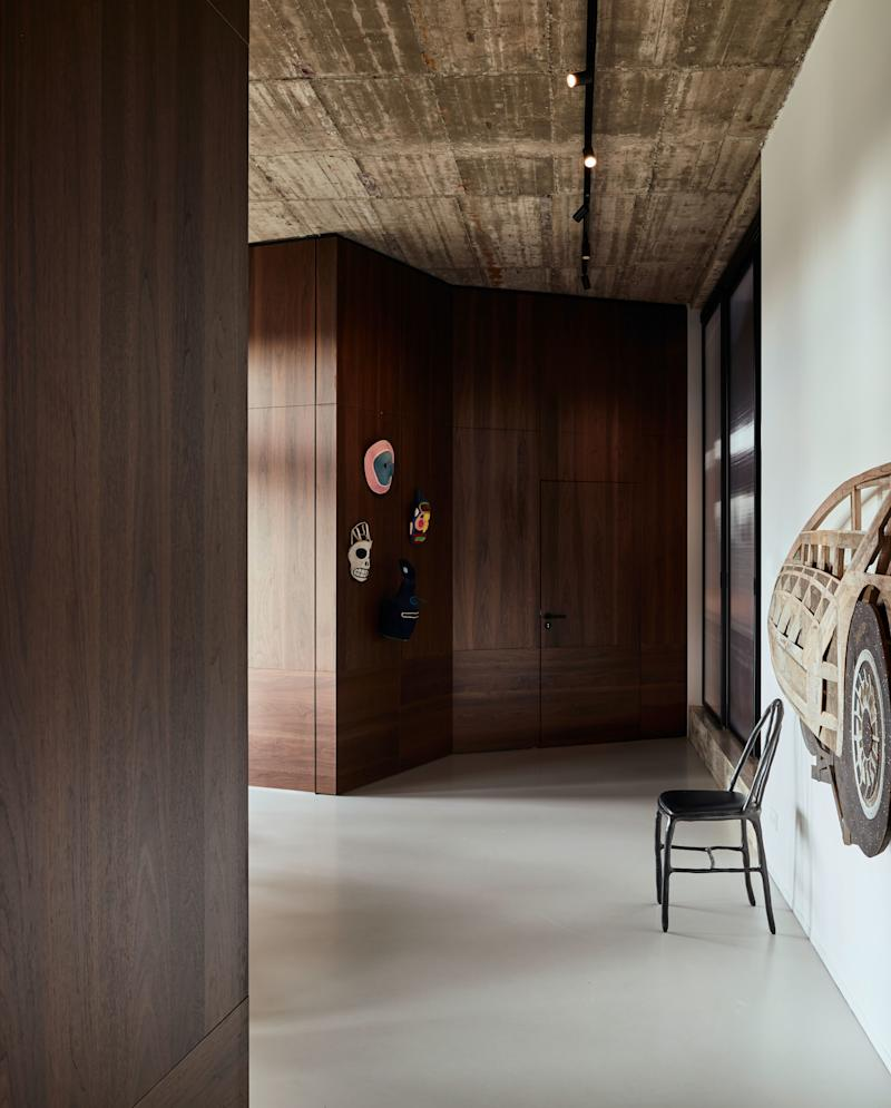 The kids' rooms are located one floor below the penthouse, on the top floor of the existing former office building. The space is characterized by its height—nearly 12 feet—and the béton brut, or raw concrete, ceiling. All rooms on this level are clad in American walnut.