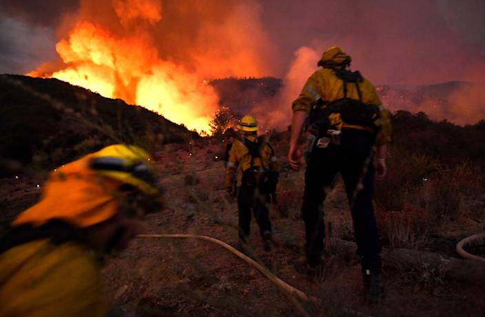 YUCAIPA, CALIFORNIA SEPTEMBER 1, 2020-Firefighters make they there way up a hill as the El Dorado Fire appriaches in Yucaipa Saturday.(Wally Skalij/Los Angeles Times)