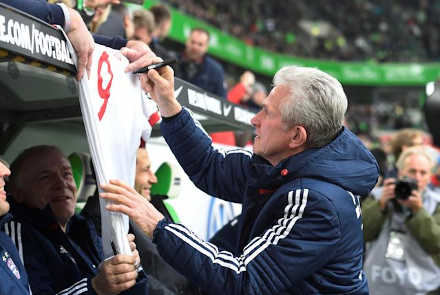 Soccer Football - Bundesliga - VfL Wolfsburg vs Bayern Munich - Volkswagen Arena, Wolfsburg, Germany - February 17, 2018 Bayern Munich coach Jupp Heynckes signs a shirt before the match REUTERS/Fabian Bimmer DFL RULES TO LIMIT THE ONLINE USAGE DURING MATCH TIME TO 15 PICTURES PER GAME. IMAGE SEQUENCES TO SIMULATE VIDEO IS NOT ALLOWED AT ANY TIME. FOR FURTHER QUERIES PLEASE CONTACT DFL DIRECTLY AT + 49 69 650050