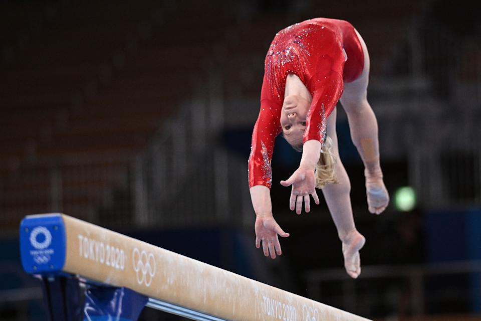 <p>USA's Jade Carey competes in the artistic gymnastics balance beam event of the women's qualification during the Tokyo 2020 Olympic Games at the Ariake Gymnastics Centre in Tokyo on July 25, 2021. (Photo by Martin BUREAU / AFP) (Photo by MARTIN BUREAU/AFP via Getty Images)</p>