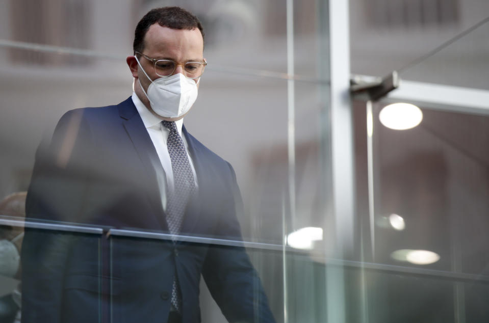 German Health Minister Jens Spahn leaves after a news conference on the coronavirus pandemic and the COVID-19 disease, in Berlin, Germany, Friday, June 18, 2021. Germany's health minister says the country has now given a first coronavirus vaccine shot to more than half of its population. (Hannibal Hanschke/Pool via AP)
