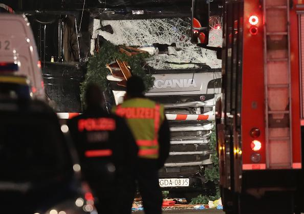 <p>Police stand near a black lorry that ploughed through a Christmas market in Berlin. Photo: Sean Gallup/Getty Images</p>