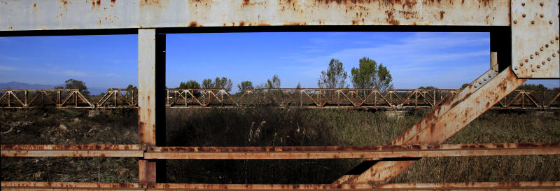 In this picture dated Nov. 3, 2012, steel supports are missing from an abandoned army bridge at the village of Adendro, in northern Greece. When Greece adopted the euro, it poured billions into modernizing its infrastructure, building spectacular bridges, highways, and a brand new rail transit network for Athens. Now, locked in recession and crushed by debt, Greeks are targeting many of those projects, gouging out the metal and selling it for scrap to feed ravenous demand driven by China and India. (AP Photo/Nikolas Giakoumidis)