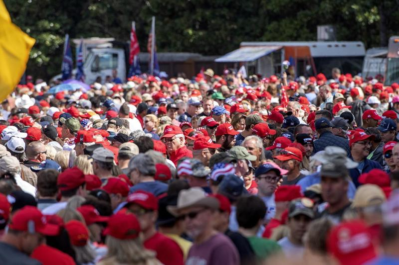 Supporters of President Donald Trump line up to enter a campaign rally Thursday.