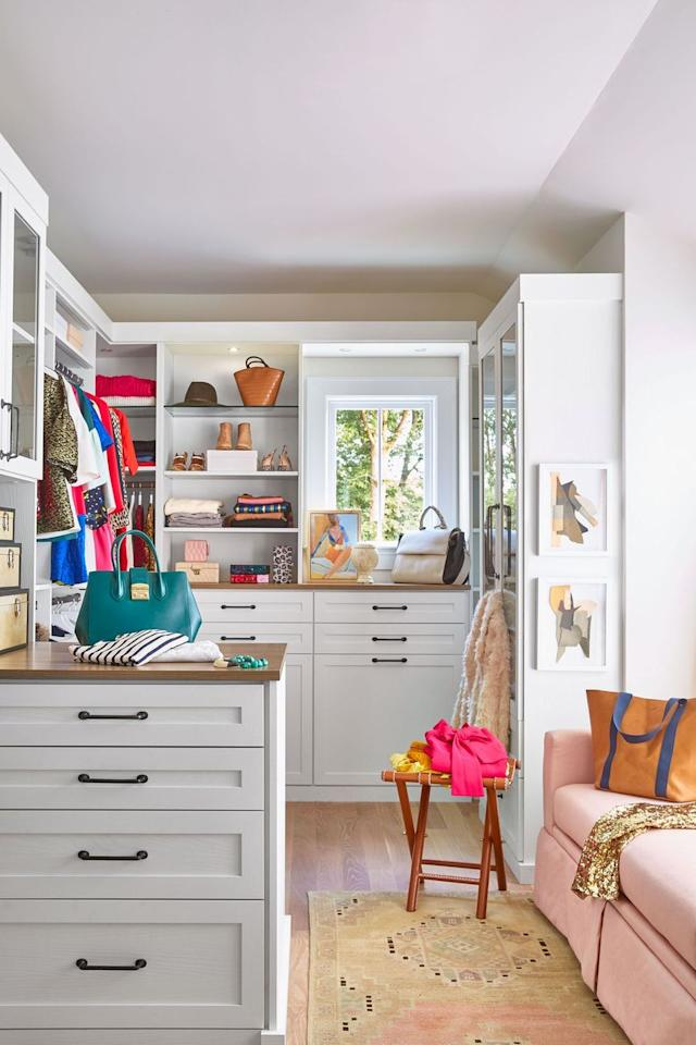 <p>Why use an armchair when you have room for a sofa? Slide up a stool and colorful area rug to complete the look, and then make a mini gallery wall to polish things off. And closet island/ dresser? Not just storage—it's motivation to fold and put away your clothes.</p>