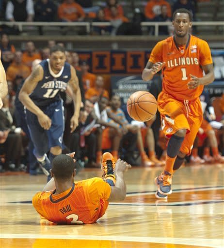 Illinois' Brandon Paul (3) scrambles for the ball and passes back to D.J. Richardson (1) during the first half against Penn State in an NCAA college basketball game Thursday, Feb. 21, 2013, in Champaign, Ill. (AP Photo/Robert K. O'Daniell)