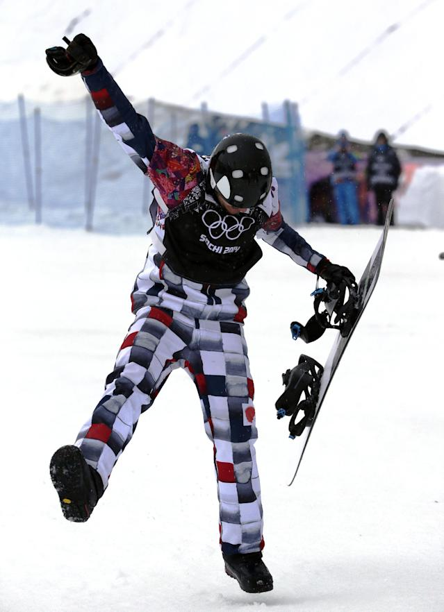Russia's Nikolai Olyunin dances after winning the men's snowboard cross semifinal at the Rosa Khutor Extreme Park, at the 2014 Winter Olympics, Tuesday, Feb. 18, 2014, in Krasnaya Polyana, Russia. (AP Photo/Andy Wong)